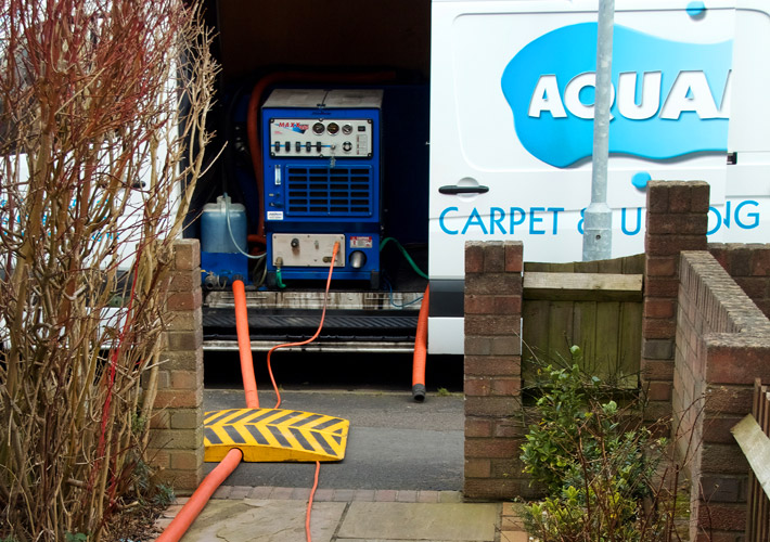 Truck mounted steam carpet cleaning
